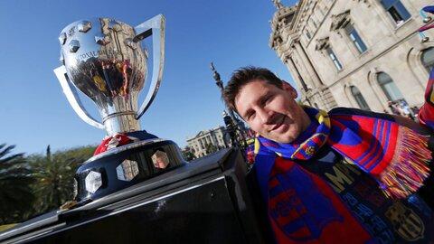 Messi y trofeo